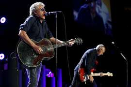Roger Daltrey (left) and Pete Townshend of The Who perform during a concert at Oracle Arena in Oakland, California, on Thursday, May 19, 2016.