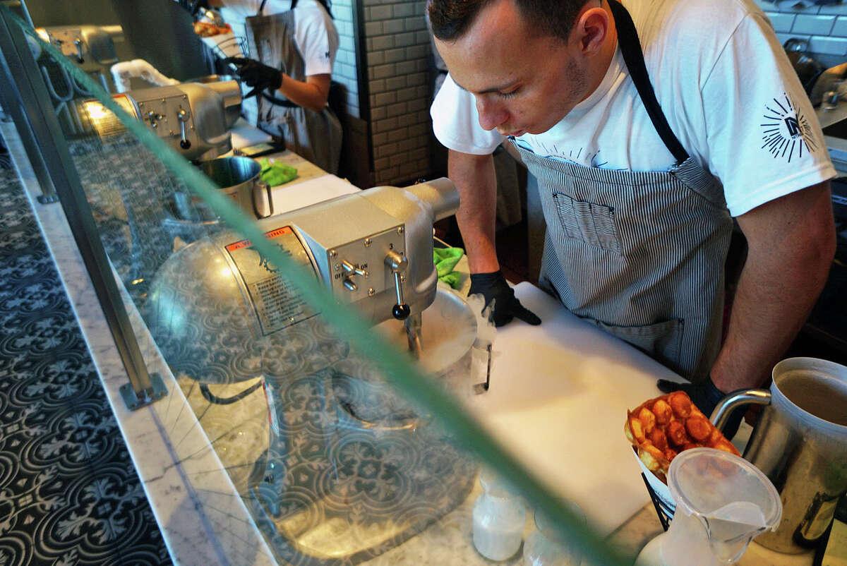 Liquid nitrogen is used to turn fresh milk into ice cream at Milkcraft, a new