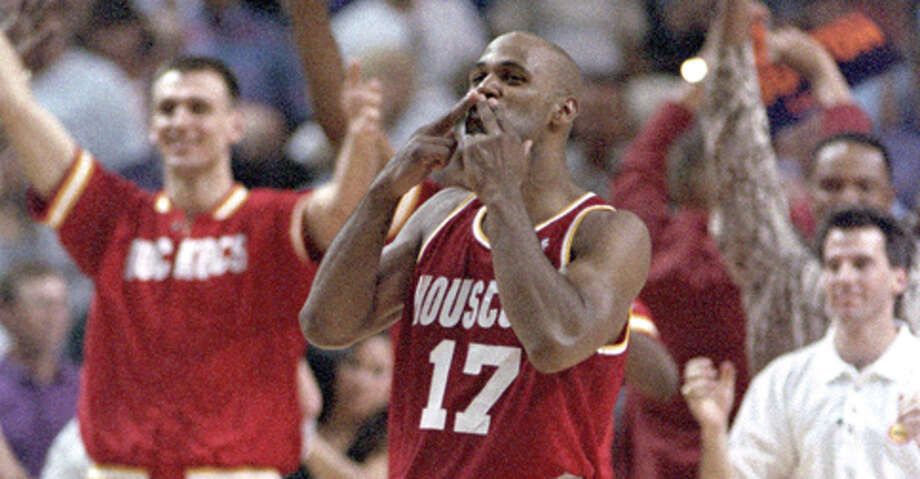 """Mario Elie blows the """"Kiss of Death"""" to the Phoenix bench after his memorable 3-pointer against the Suns in Game 7 of their second-round series May 20, 1995. Photo: Richard Carson /Houston Chronicle"""