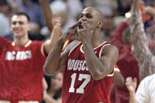 "Mario Elie blows the ""Kiss of Death"" to the Phoenix bench after his memorable Game 7 3-pointer against the Suns on May 20, 1995. Click through the gallery to relieve the most memorable moments from the Rockets' 1994-95 championship runs."