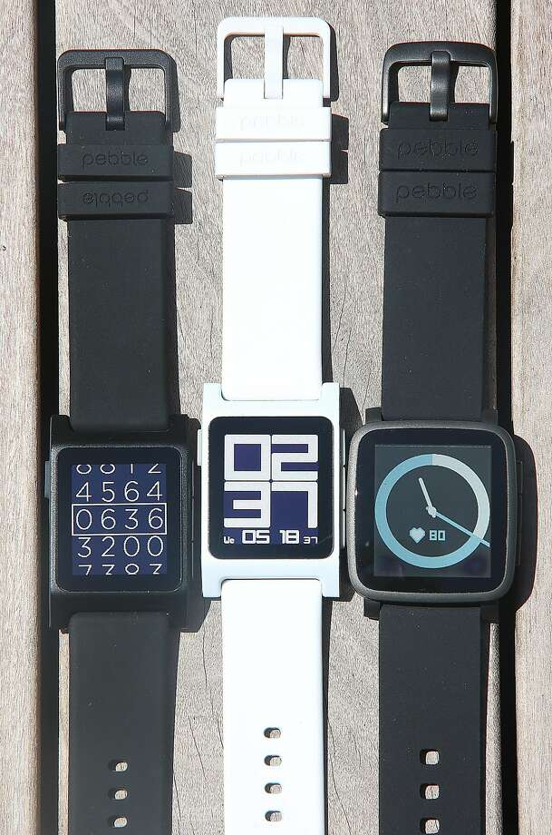 At left and middle are Pebble 2 watches and a Pebble Time 2 watch seen at right at Pebble in Redwood City, Calif., on Wednesday, May 18, 2016. Photo: Liz Hafalia, The Chronicle