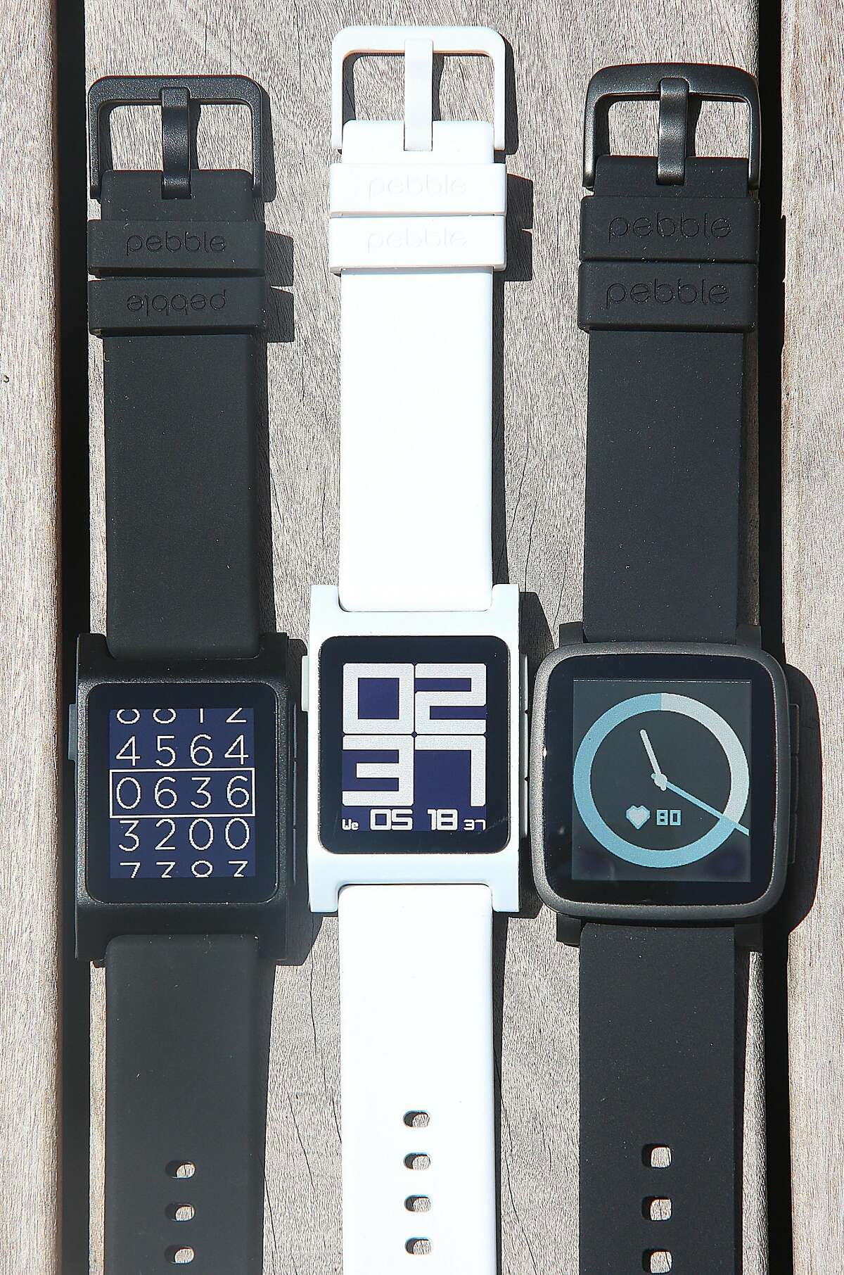 At left and middle are Pebble 2 watches and a Pebble Time 2 watch seen at right at Pebble in Redwood City, Calif., on Wednesday, May 18, 2016.