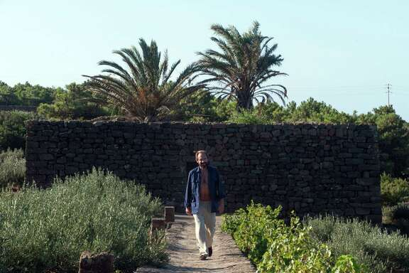 """This image released by Fox Searchlight shows Ralph Fiennes in a scene from """"A Bigger Splash.""""  (Jack English/Fox Searchlight via AP)"""