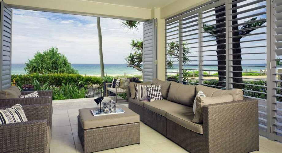 Two trends in new beachside properties more outdoor living space and for more windows. - Photo courtesy of Cordillera Ranch