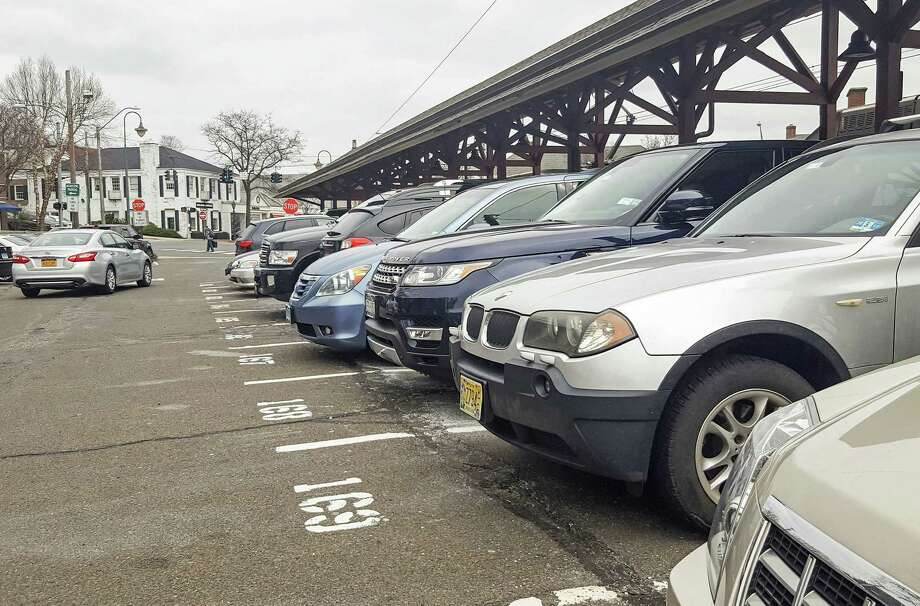 The town will soon institute a parking permit waiting list fee. Photo: Thane Grauel / Hearst Connecticut Media / New Canaan News