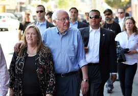Democratic presidential candidate Bernie Sanders (2nd-L) walks with his wife Jane Sanders (L) in San Francisco, California on May 18, 2016.  / AFP PHOTO / JOSH EDELSONJOSH EDELSON/AFP/Getty Images