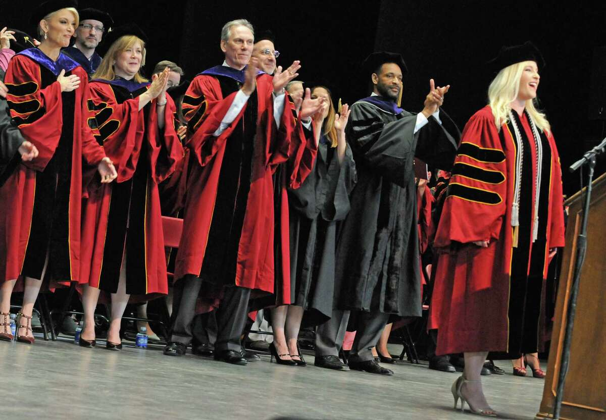 Megyn Kelly, Fox News anchor, left, reacts as 2016 graduate Lindsey R. Dodd, right, finishes the National Anthem with a flourish during the 165th Albany Law School Commencement at SPAC on Friday May 20, 2016 in Saratoga Springs. (Michael P. Farrell/Times Union)