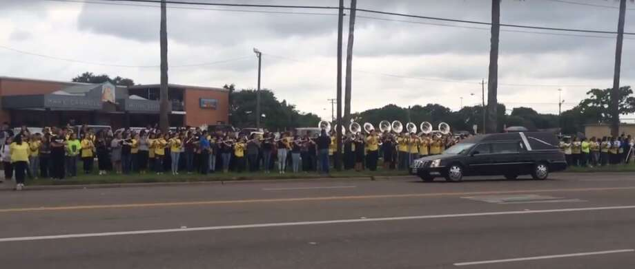 More than a thousand high school students lined the street outside Carroll High School, in Corpus Chrisit, to honor the life of 17-year-old Elissa Longoria, as her funeral procession passed on May 19, 2016. Photo: Provided By Carroll High School