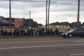 More than a thousand high school students lined the street outside Carroll High School, in Corpus Chrisit, to honor the life of 17-year-old Elissa Longoria, as her funeral procession passed on May 19, 2016.