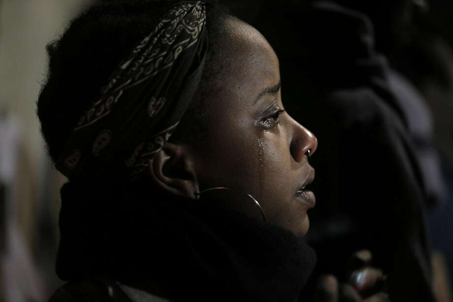 China Pharr cries as she listens to community members speak during a vigil at the site where Mario Woods was shot and killed by San Francisco Police in December 2015. Photo: Carlos Avila Gonzalez, The Chronicle