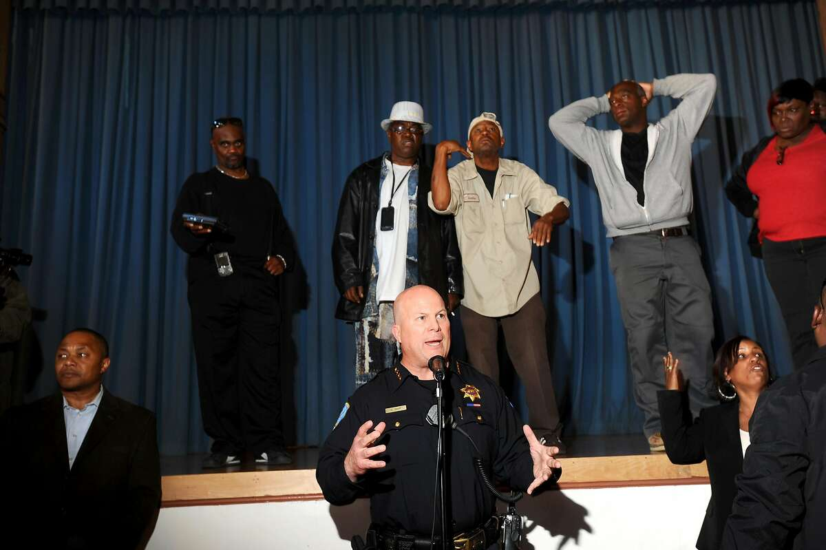 San Francisco Police Chief Greg Suhr addresses Bayview residents upset about the police shooting of Kenneth Wade Harding on Wednesday, July 20, 2011, in San Francisco. About 300 people gathered for the meeting which ended early following outbursts from some attendees.