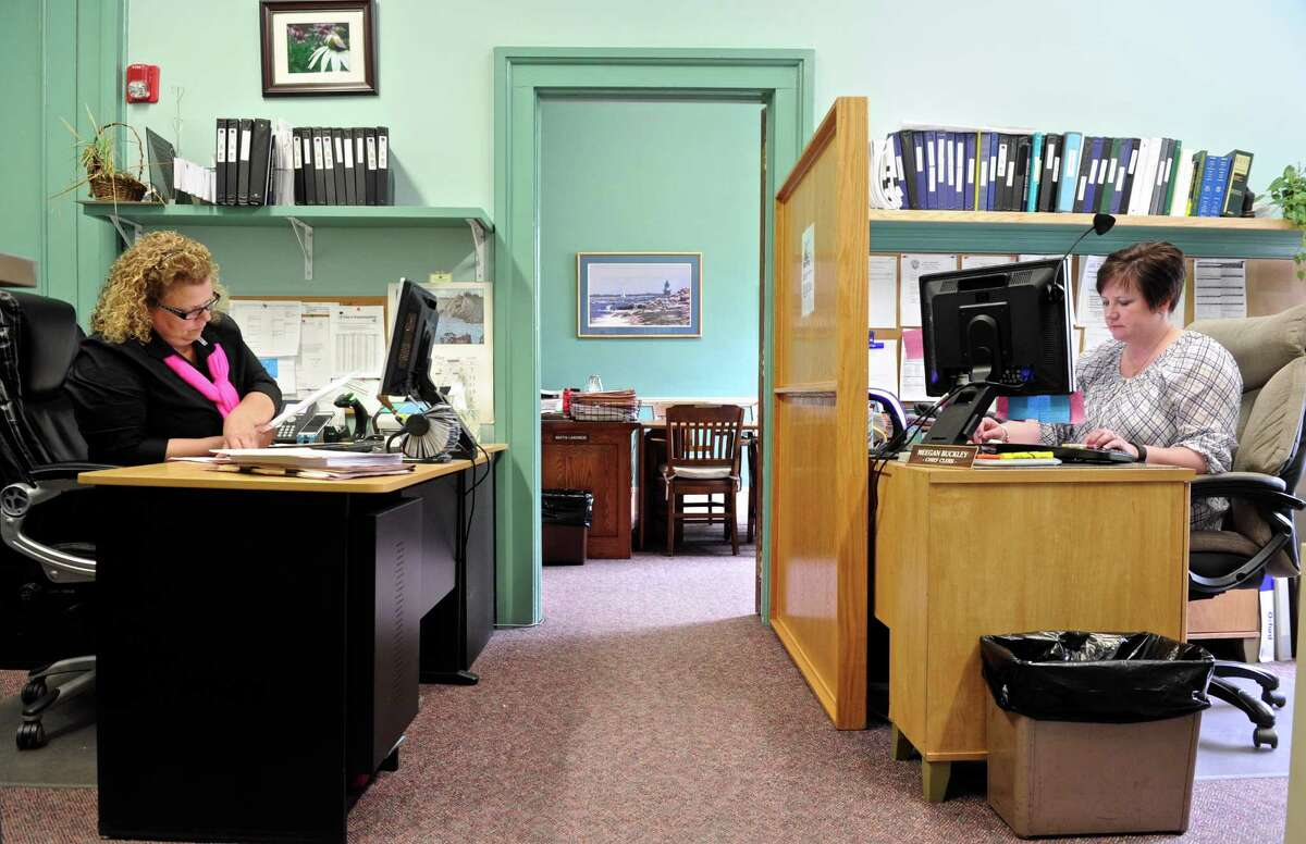 Meegan Buckley, Chief Clerk, right, and Nanci Howard, Assistant Clerk, left, work in the Probate Court office in New Milford's Town Hall. New Milford's mayor and the Probate Court judge are trying to move the probate court out of town hall and across the street into 25 Church Street to alleviate the overcrowding in the office. Thursday, May 19, 2016, in New Milford, Conn.