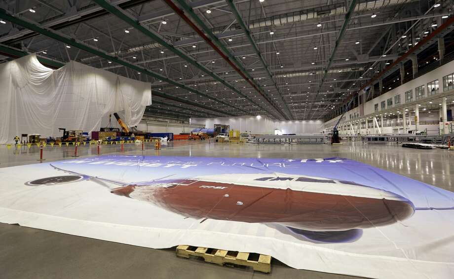 A giant tarp lies on the floor of the new Boeing 777X Composite Wing Center a day ahead of its grand opening, Thursday, May 19, 2016, in Everett, Wash. The facility, which is still under construction, will manufacture the world's largest composite wings for Boeing's newest commercial jetliner, the 777X. The new $1 billion, 1 million square foot center is close to the widebody plant where the 777X will be assembled because the wings are the largest Boeing has ever built — 114 feet long and 23 feet wide. (AP Photo/Elaine Thompson) Photo: AP