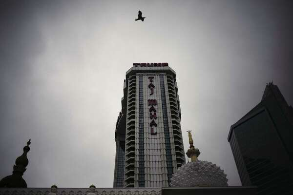 A bird flies near the Trump Taj Mahal casino and hotel, owned by Trump Entertainment Resorts Inc., in Atlantic City, New Jersey, U.S., on Wednesday May 4, 2016. Atlantic City made $1.8 million in interest payments, averting what would have been New Jersey's first municipal default since the Great Depression as state lawmakers bicker over how to assist the troubled gambling hub. Photographer: John Taggart/Bloomberg