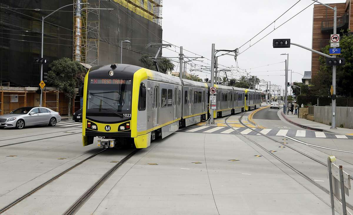 This Wednesday, May 18, 2016 photo shows a test train at the new Metro Expo Line in Santa Monica, Calif. For the first time since the 1950s, a Southern California light rail line will extend to the Pacific. Starting Friday, May 20, 2016, with the opening of the 6.6-mile extension of the Expo Line, riders can now take Metro rail from the far-inland suburb of Azusa some 40 miles to the sands of Santa Monica. (AP Photo/Nick Ut)