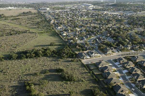 Oak Run Boulevard ends by an open field by the Oak Run subdivision in New Braunfels, Texas, Thursday, Feb. 18, 2016. Veramendi, a 2,400-acre master planned community is in the works for the undeveloped land.