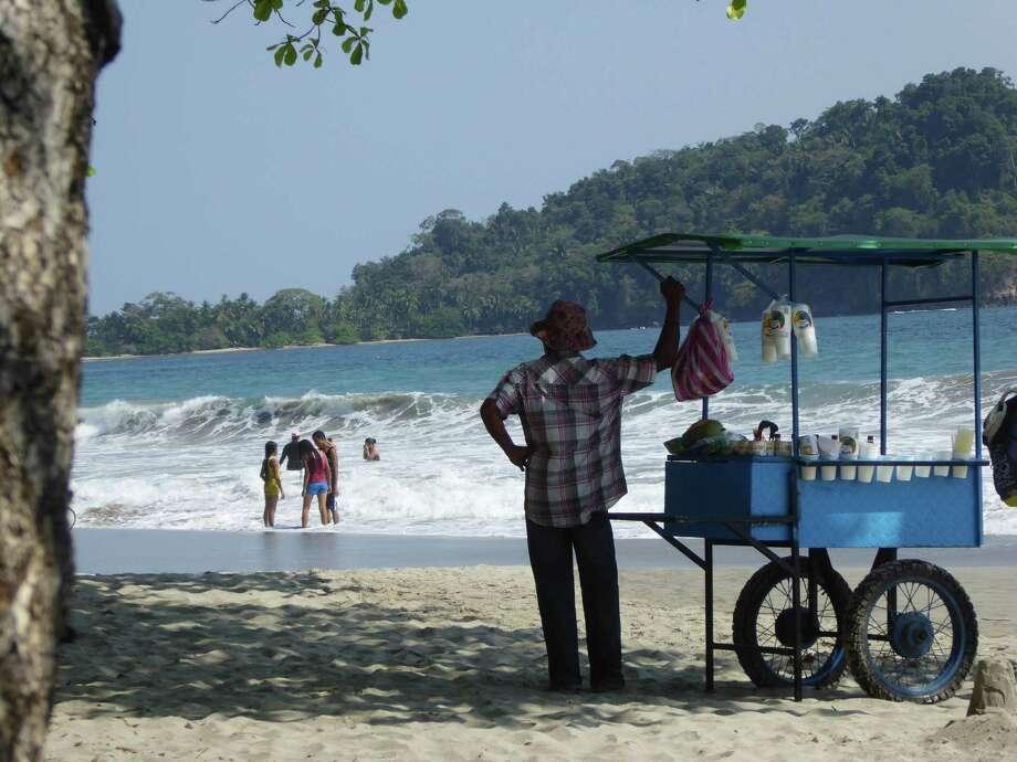 A vendor sells coconut drinks at a beach at Manuel Antonio, Costa Rica. Photo: Evelyne Horovitz / For The Washington Post