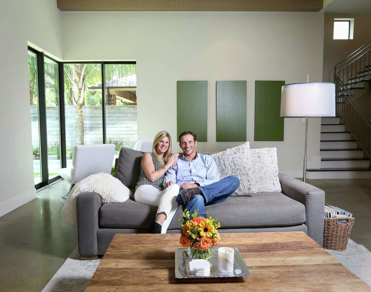 Leah and John Leggett use their main-floor great room for entertaining. The corner behind them opens up for frameless, indoor-outdoor traffic.
