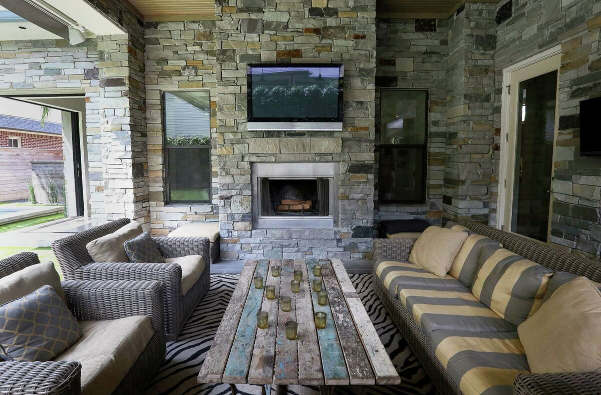 Outdoor living With a couple of couches, a TV, an outdoor kitchen and a fireplace, there may never be a reason to go inside again.