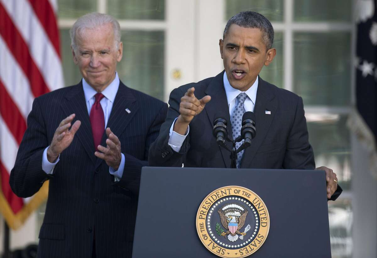 President Barack Obama, with Vice President Joe Biden, gestures as he speaks in the Rose Garden of the White House in Washington, Tuesday, April 1, 2014, about the Affordable Care Act. The deadline to sign up for health insurance under the Affordable Care Act passed at midnight Monday night. (AP Photo/Carolyn Kaster)