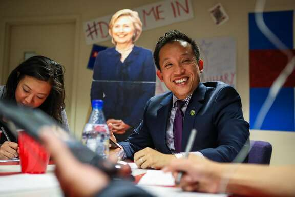 (l-r)  Supervisor David Chiu (center) smiles after making a successful phone call  on behalf of Hillary Clinton, at Hillary Clinton's local office, in San Francisco, California, on Thursday, May 19, 2016.