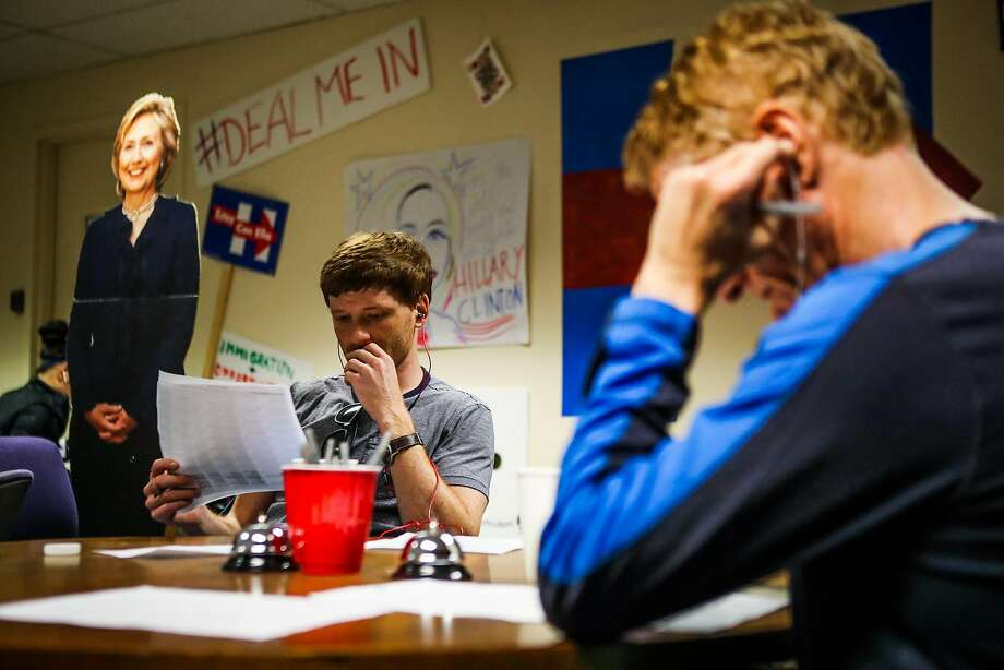 Neil Gershgorn (left) and Michael Glogowski talk on the phone to potential voters at Hillary Clinton's campaign office in San Francisco. Photo: Gabrielle Lurie, Special To The Chronicle