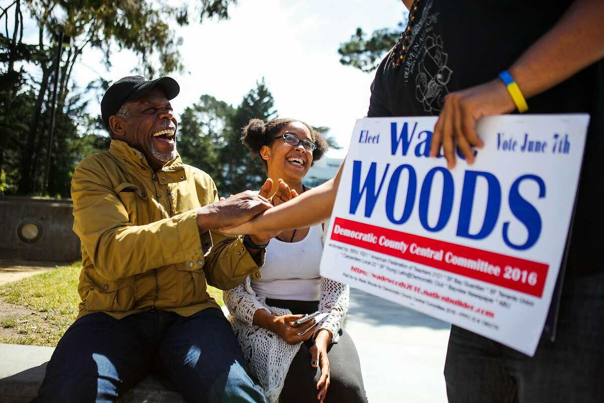 Actor Danny Glover (left) laughs with Larry Dorsey (right) and Alexis Logan (center) after taking a photograph with them during a Bernie Sanders event to get students to register to vote, at San Francisco State University, in San Francisco, California, on Friday, May 20, 2016.