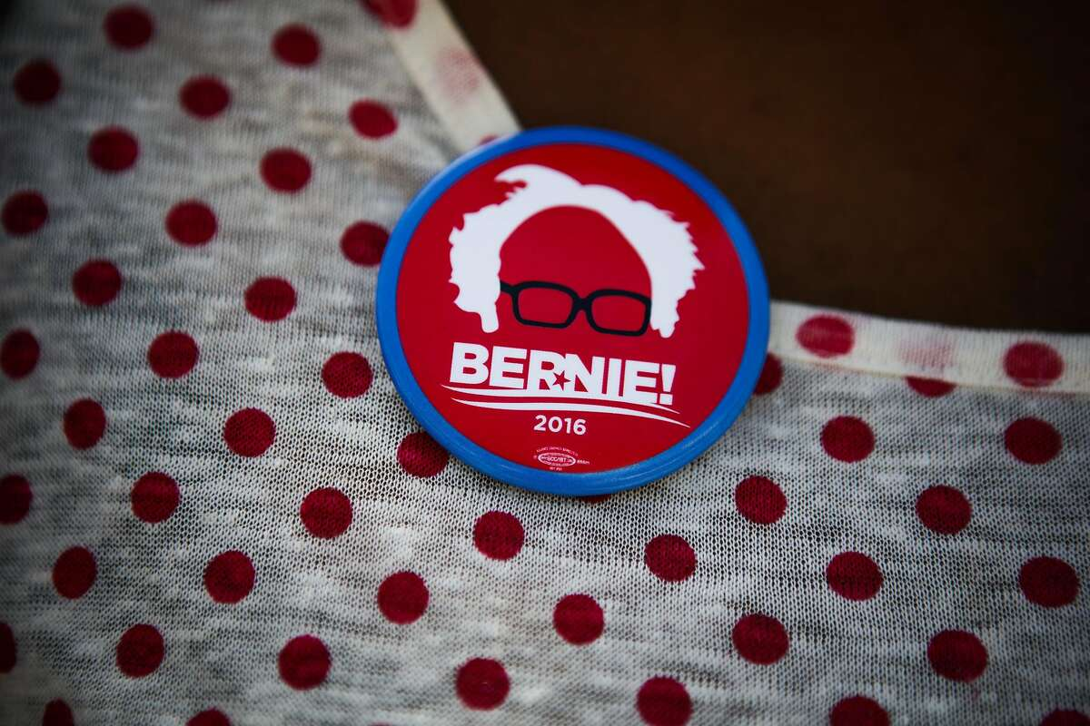 Student Ade Adegunwa's shows off her Bernie Sanders pin at an event to get students to register to vote, at San Francisco State University, in San Francisco, California, on Friday, May 20, 2016.