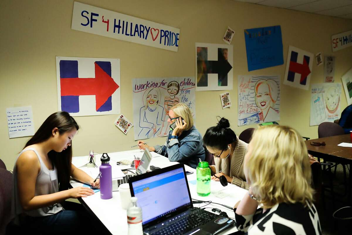 Becky Museat (second from left) and Isabella Liu (second from right), and Christina Lauridsen (right) make phone calls to Democrats to try and sway them to vote for Hillary Clinton, at Hillary Clinton's local office, in San Francisco, California, on Thursday, May 19, 2016.