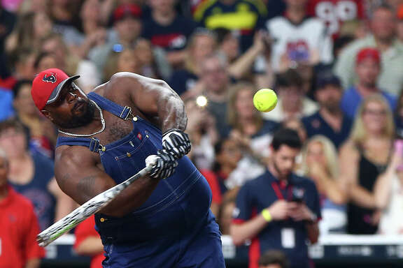 Houston Texans nose tackle Vince Wilfork (75) bats during the 4th annual J. J. Watt Charity Classic at Minute Maid Park Saturday, May 14, 2016, in Houston. ( Jon Shapley / Houston Chronicle )