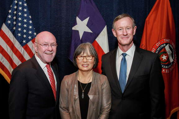 Dr. David Poplack and June Poplack, from left, with University of Texas System Chancellor William H. McRaven