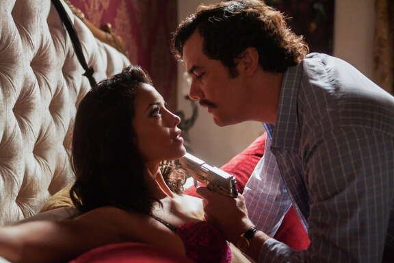 """Brazilian actor Wagner Moura, right, playing the role of Pablo Escobar in the original Netflix series """"Narcos"""" with Mexican actress Stephanie Sigman as Valeria Vélez."""