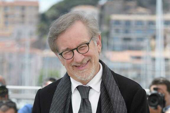 """US director Steven Spielberg smiles on May 14, 2016 during a photocall for the film """"The BFG"""" at the 69th Cannes Film Festival in Cannes, southern France.  / AFP PHOTO / ANNE-CHRISTINE POUJOULATANNE-CHRISTINE POUJOULAT/AFP/Getty Images"""