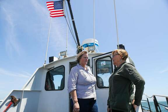 (l-r) Owners of Westar marine services, Wendy Morrow and Mary McMillan chat on their tugboat, as it brings emergency gear to a large tanker, in San Francisco, California, on Wednesday, May 18, 2016.