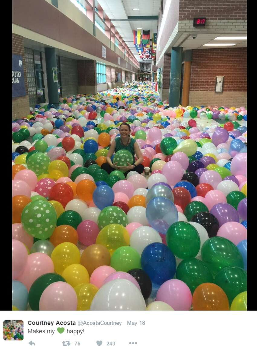 What's a senior prank without balloons? Seniors at McNeil High School in Austin inflated thousands of balloons to fill school halls on May 17, 2016.