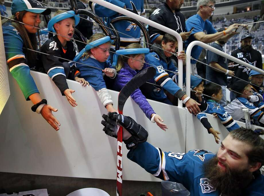 (left to right with balloons on their heads) Cameron Wildt, 9 of San Jose and his 11-year-old twin sisters Elizabeth and Anna greet San Jose Sharks' Brent Burns after warm ups before Sharks' 3-0 win over St. Louis Blues during Game 3 of NHL Playoffs' Western Conference Finals at SAP Center in San Jose, Calif., on, Calif., on Thursday, May 19, 2016. Photo: Scott Strazzante, The Chronicle