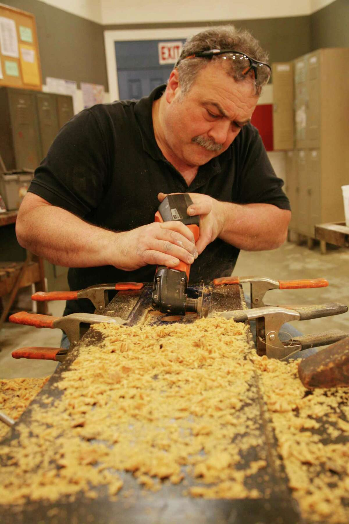 """Mark DeVito, a furniture restorer in Stamford, learned the business from his dad. He is one of the experts who helps contestants refurbish vintage furniture pieces on """"Flea Market Flip."""""""