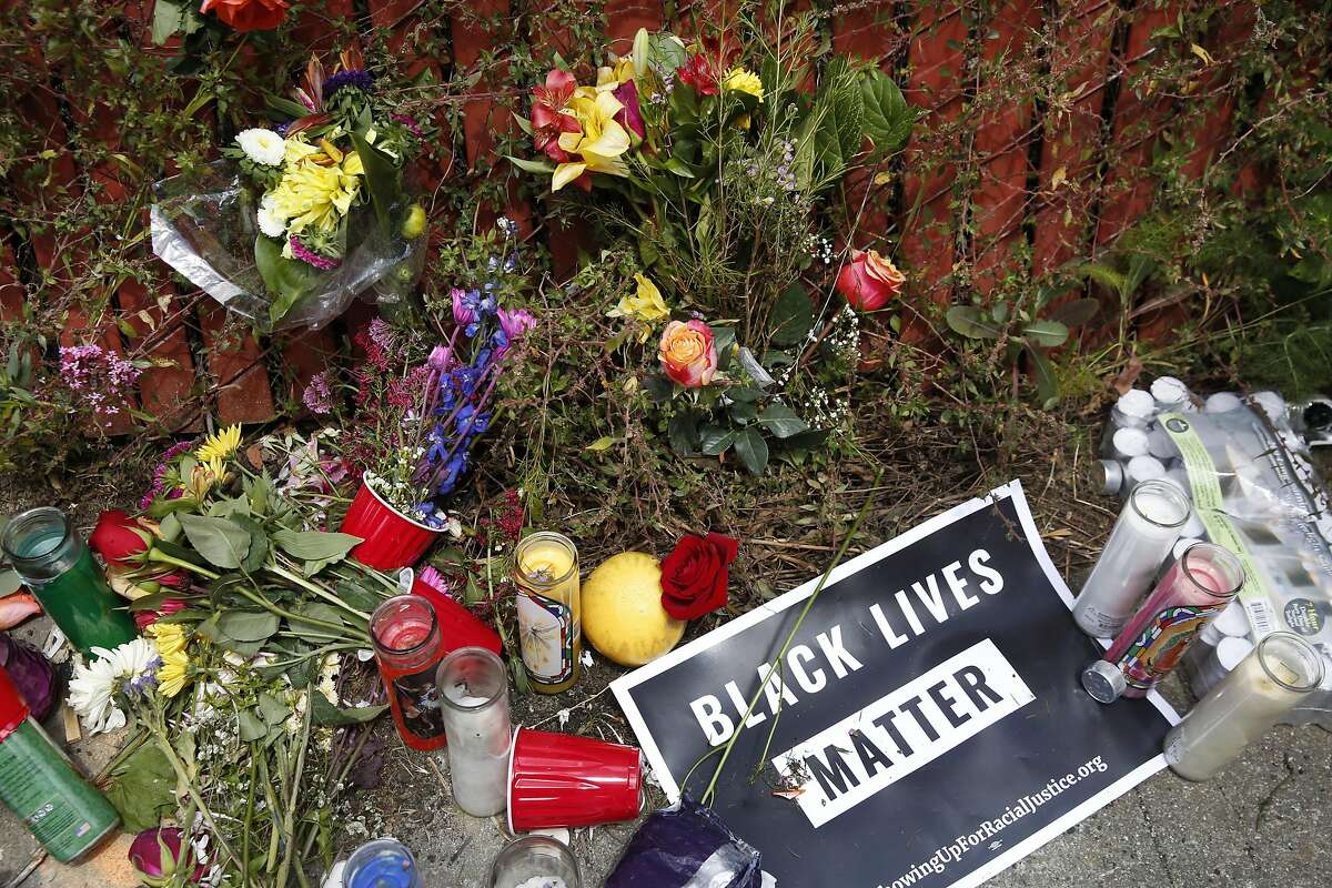 A memorial of flowers, candles and other offerings at the scene where San Francisco police fatally shot a woman on Helena street near Elmira street in the Bayview neighborhood May 20, 2016 in San Francisco, Calif. According to a police witness, officers began pursuing a car that came up as stolen in their system and after the woman crashed the car into a parked vehicle, she was shot once while officers tried to remove her from the car and she died from the gunshot wound.