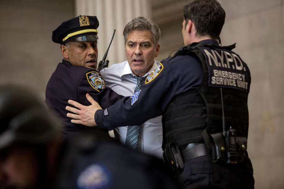 "George Clooney (center) is restrained by police officers in his latest film, ""Money Monster."" A reader would like to restrain Clooney when it comes to injecting himself into the presidential campaign. The movie star is supporting Democrat Hillary Clinton. Photo: Atsushi Nishijima /TriStar Pictures / ©2015 CTMG, Inc. All rights reserved."