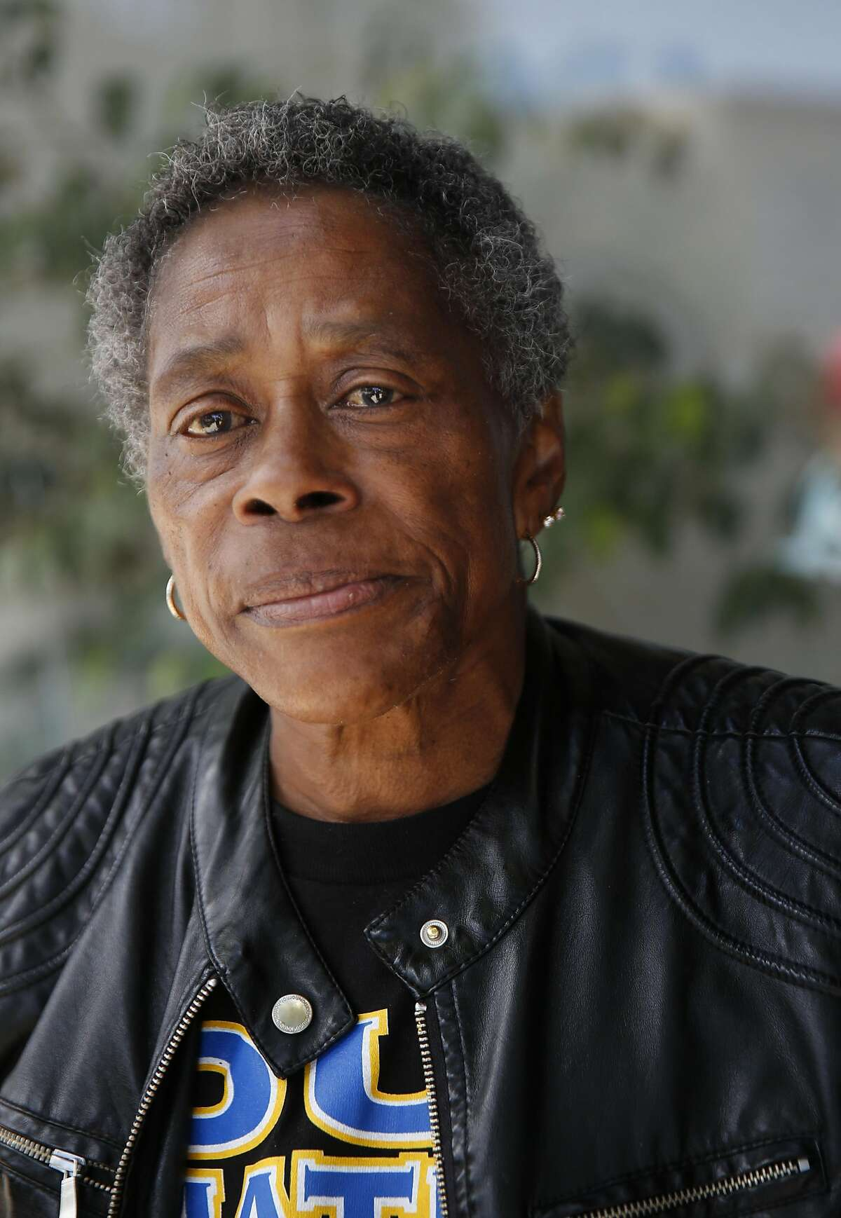 """Sally Taylor, 63, pictured outside of a beauty salon in the Bayview neighborhood May 20, 2016 in San Francisco, Calif. Taylor, who is from the Bayview, says """"I am tired of the killing and maybe we will see if there will be a change."""""""