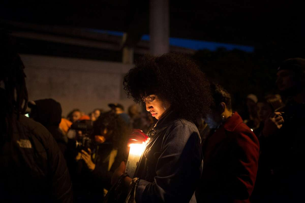 Hannah Wodaje, president of SF State's Black Student Union, attends a vigil for a 27-year-old woman shot and killed by a San Francisco police sergeant earlier in the day on Thursday, May 19, 2016, in San Francisco.