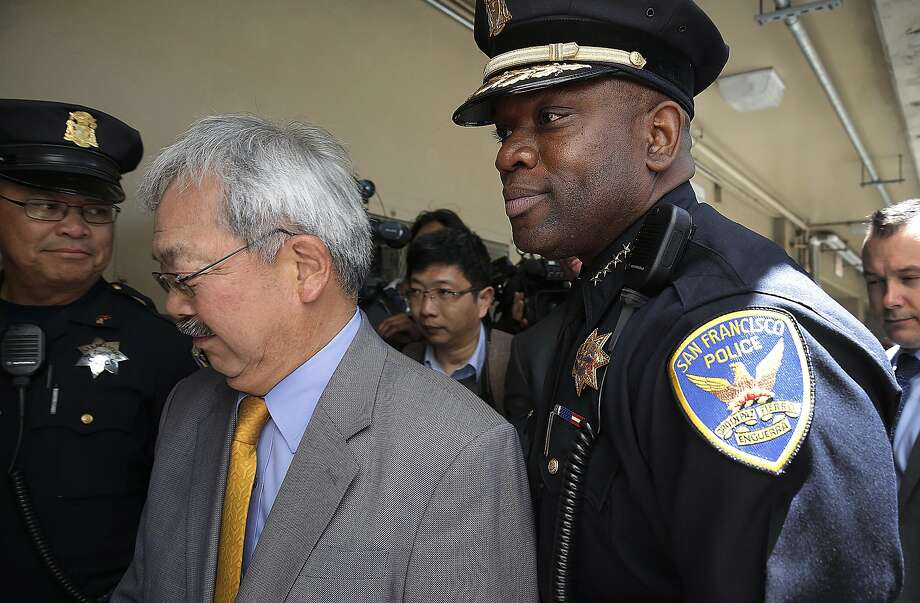Acting Police Chief Toney Chaplin and Mayor Ed Lee after his first news conference at the Ping Yuen housing development. Photo: Liz Hafalia, The Chronicle