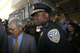 Acting Chief Toney Chaplin (middle) meets with Mayor Ed Lee after his first press conference at the Ping Yuen center in Chinatown in San Francisco, California, as they head into the housing project on Friday, May 20, 2016.   There were over 800 reported crimes in the housing complex last year.