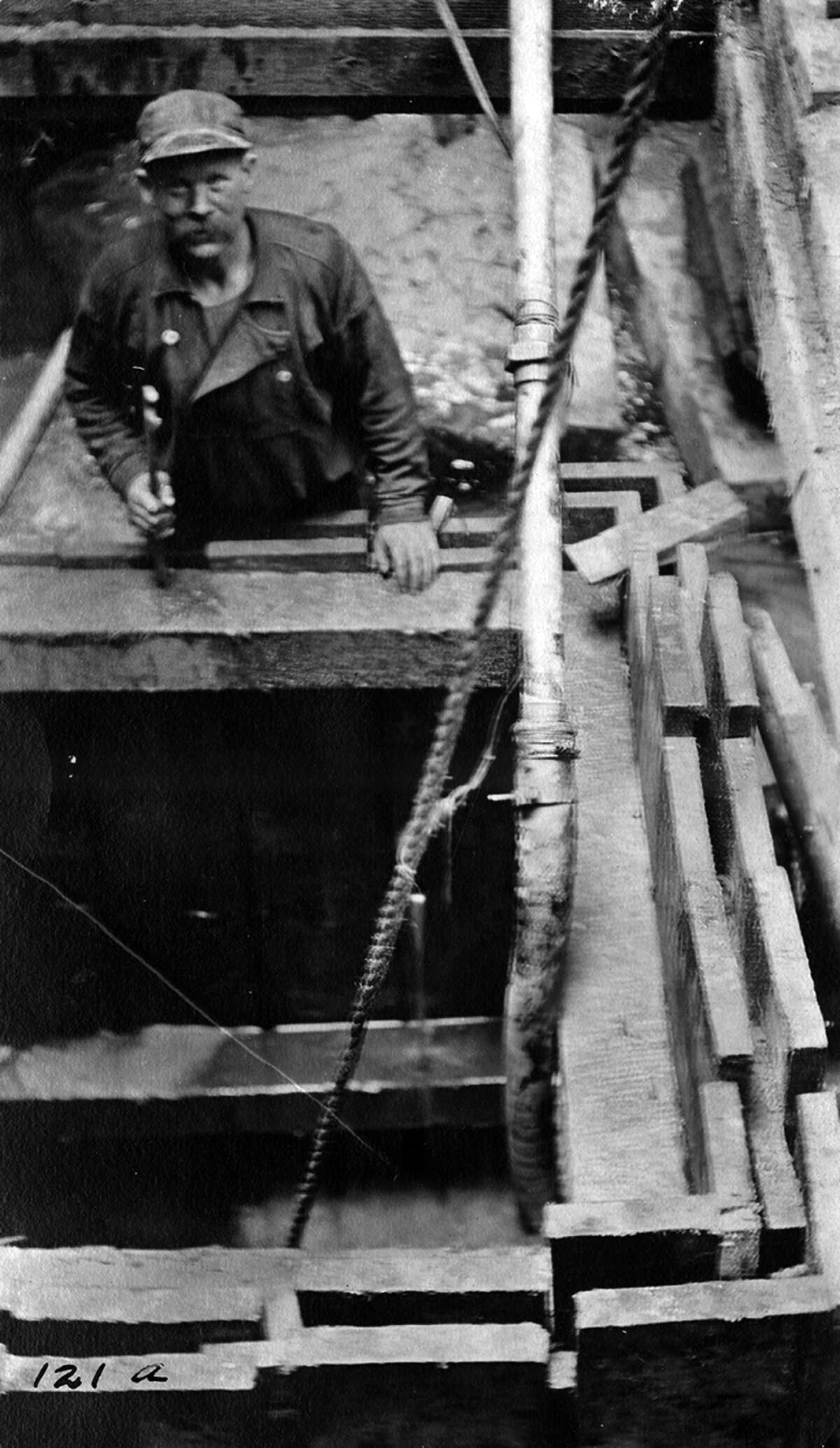 A Seattle worker pauses during construction of the Lander Street sewer line on April 10, 1910.