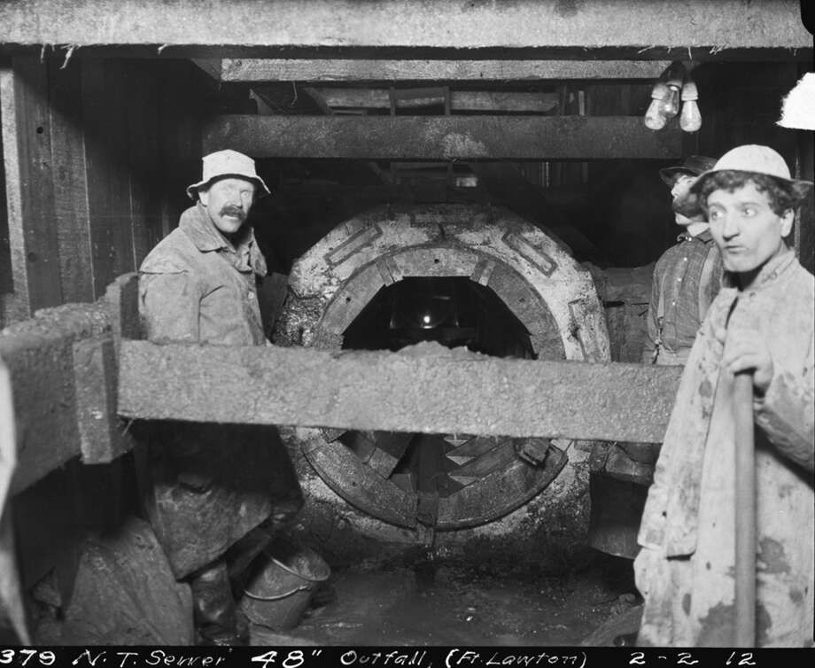 Workers pose at a sewer line at Fort Lawton, now Discovery Park. Pictured Feb. 2, 1912. Photo: Seattle Municipal Archives