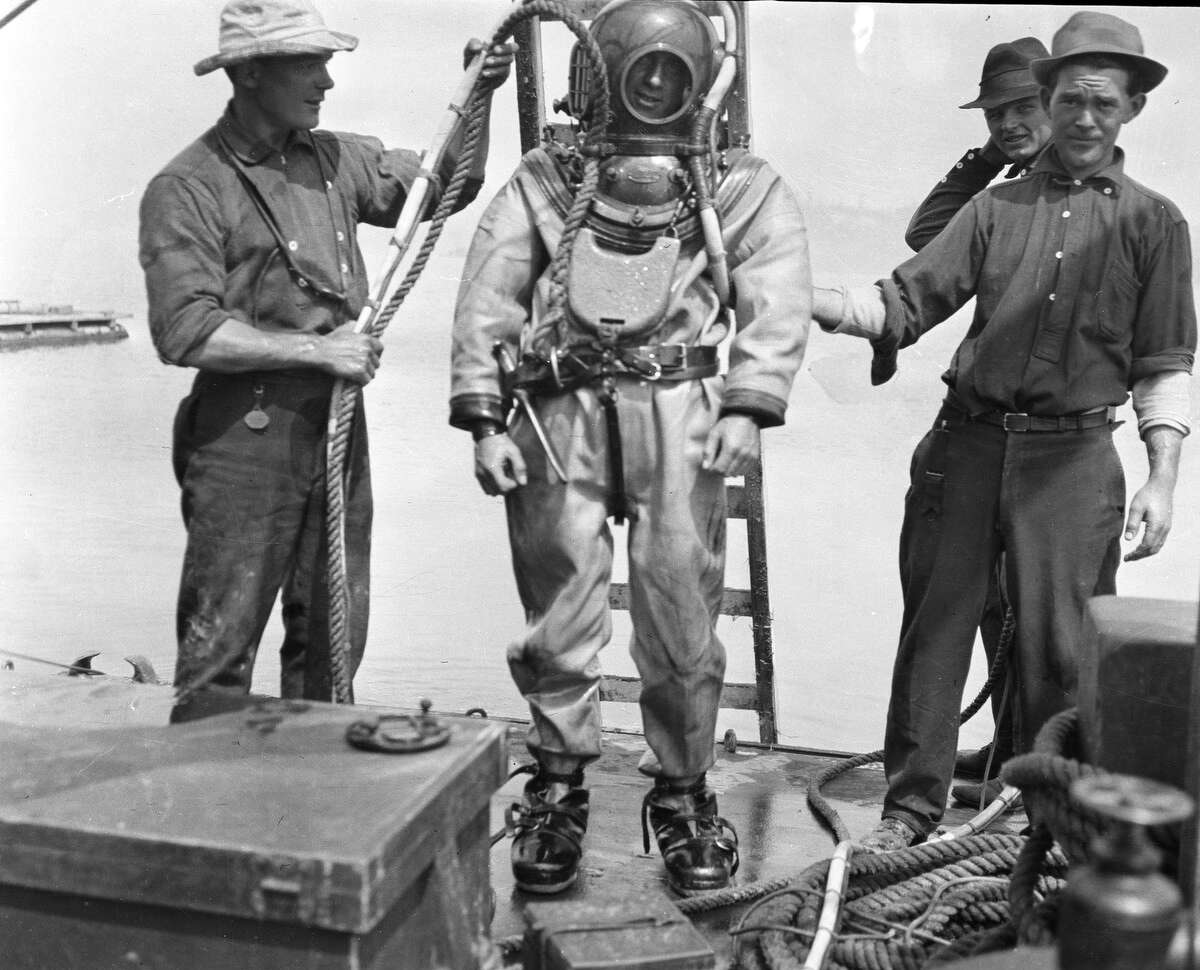 A diver prepares to examine a Seattle sewer on Aug. 2, 1912.