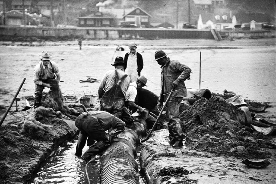 Take a look at the workers who built Seattle's sewers. Not for the claustrophobic. Above, workers are pictured on Sept. 5, 1934, installing a sewer outfall in West Seattle. Photo: Seattle Municipal Archives