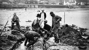 Workers are pictured Sept. 5, 1934, installing a sewer outfall in West Seattle.