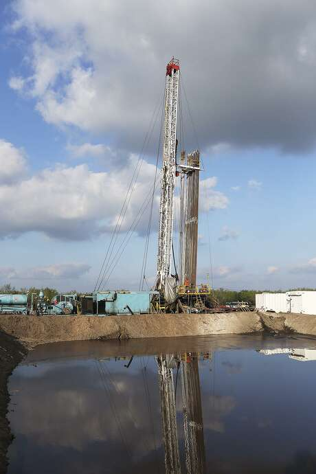 An oil drilling rig stands in Zavala County. South Texas' Eagle Ford Shale has seen 46 rigs return to the field since June, when the rig count hit 29, nearly 90 percent fewer than its peak of 214 in June 2014. Photo: San Antonio Express-News File Photo / © 2015 San Antonio Express-News