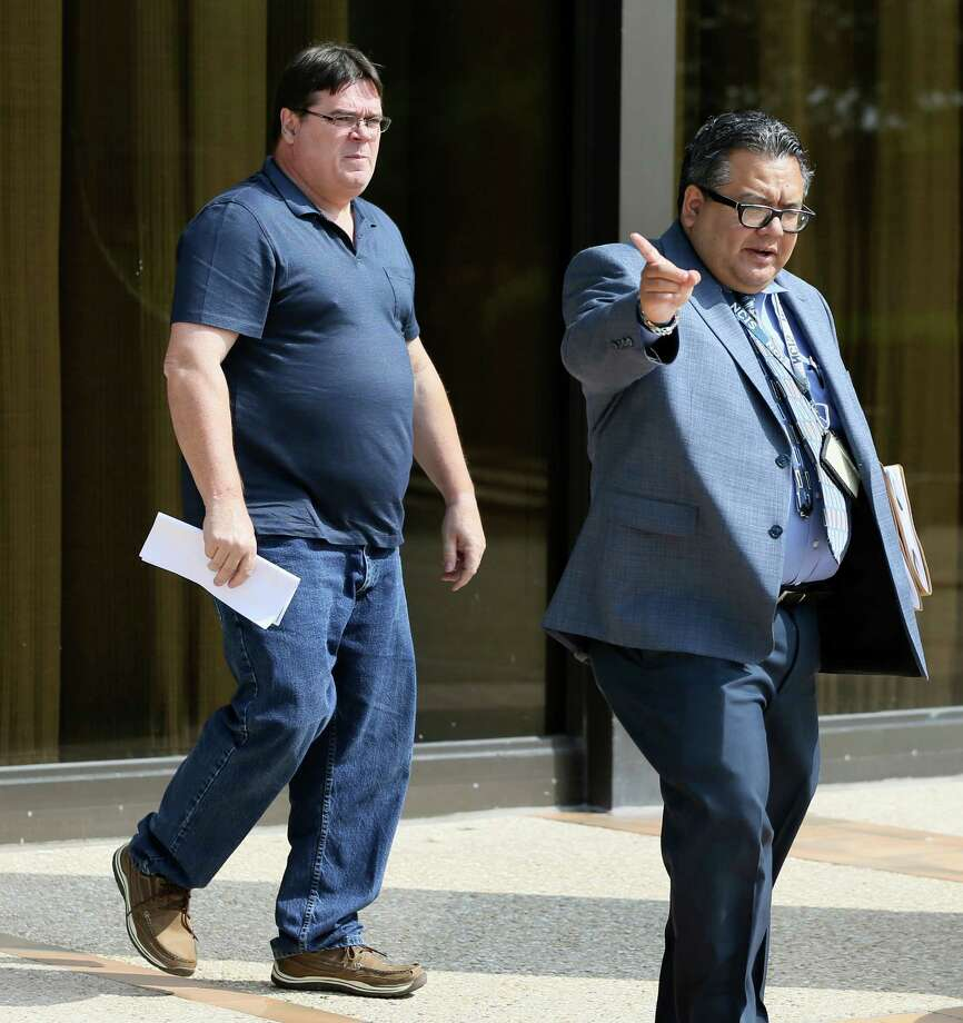 Theodore De Aubrey (left), 57,  a former math teacher at La Vernia High School, leaves the federal courthouse after being released on bond on Friday, May 20, 2016.  De Aubrey was indicted on federal child pornography charges. Photo: Marvin Pfeiffer, San Antonio Express-News / © 2016 San Antonio Express-News